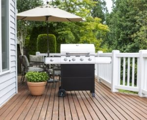 Large barbecue cooker on cedar deck - natural gas BBQ