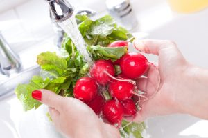 saving water at home - washing vegetables