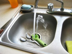 saving water at home - kitchen sink